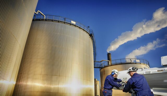 bigstock-oil-workers-with-pumps-and-lar-77881832